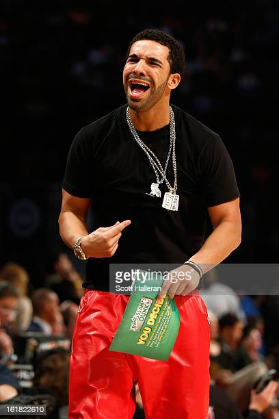 Rapper Drake reacts during the Sprite Slam Dunk Contest part of 2013 NBA AllStar Weekend at the Toyota Center on February 16 2013 in Houston Texas...