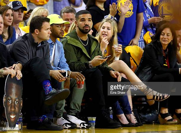 Rapper Drake sits courtside as the Golden State Warriors take on the Cleveland Cavaliers in Game 5 of the 2016 NBA Finals at ORACLE Arena on June 13...