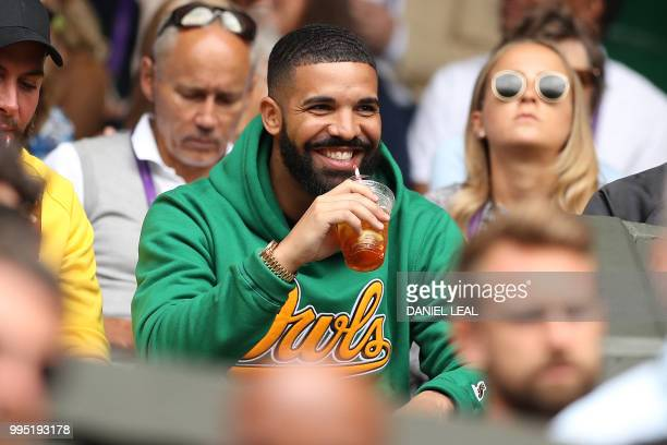 Rapper Drake sits on Centre Court before US player Serena Williams plays against Italy's Camila Giorgi during their women's singles quarterfinal...