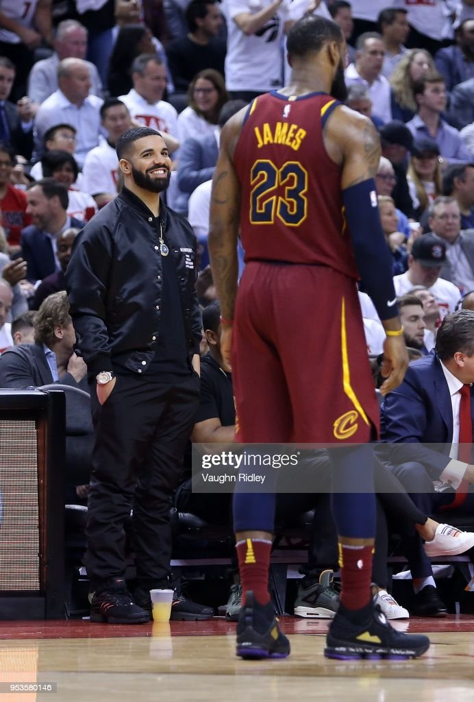 Rapper Drake smiles at LeBron James #23 of the Cleveland Cavaliers in the second half of Game One of the Eastern Conference Semifinals against the Toronto Raptors during the 2018 NBA Playoffs at Air Canada Centre on May 1, 2018 in Toronto, Canada.