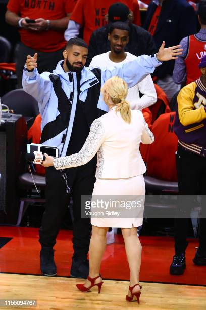 Rapper Drake speaks to TV personality Doris Burke before Game Five between the Toronto Raptors and the Golden State Warriors of the 2019 NBA Finals...