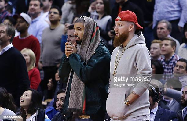 Rapper Drake watches a freethrow from his courtside seat during the second half of an NBA game between the Portland Trail Blazers and the Toronto...