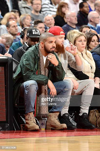 Rapper Drake watches the Toronto Raptors play against the Portland Trail Blazers on March 4 2016 at the Air Canada Centre in Toronto Ontario Canada...