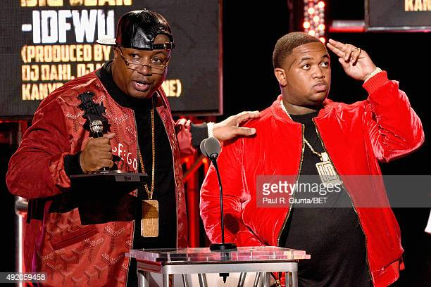 Rapper E40 and DJ Mustard speak onstage at the BET Hip Hop Awards Show 2015 at the Atlanta Civic Center on October 9 2015 in Atlanta Georgia