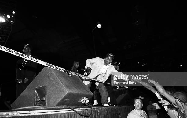 Rapper EazyE from NWA greets fans during his performance during the 'Straight Outta Compton' tour at the Mecca Arena in Milwaukee Wisconsin in June...