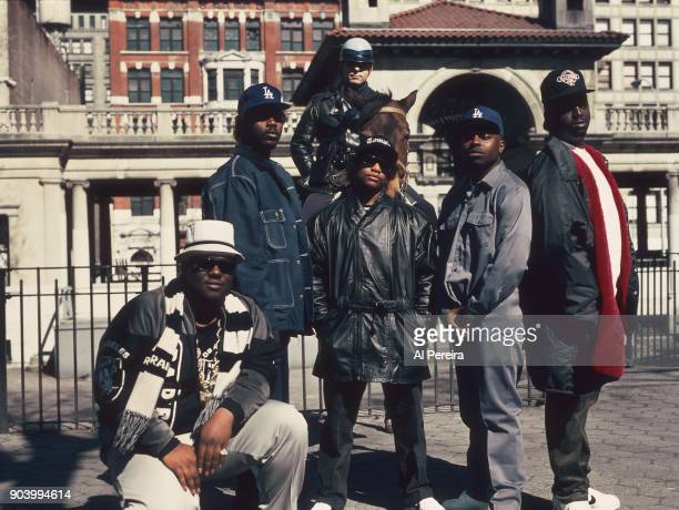 Rapper EazyE poses for a portrait with the rap group 'Above the Law' and a horse riding police officer in April 1990 in Union Square in New York New...