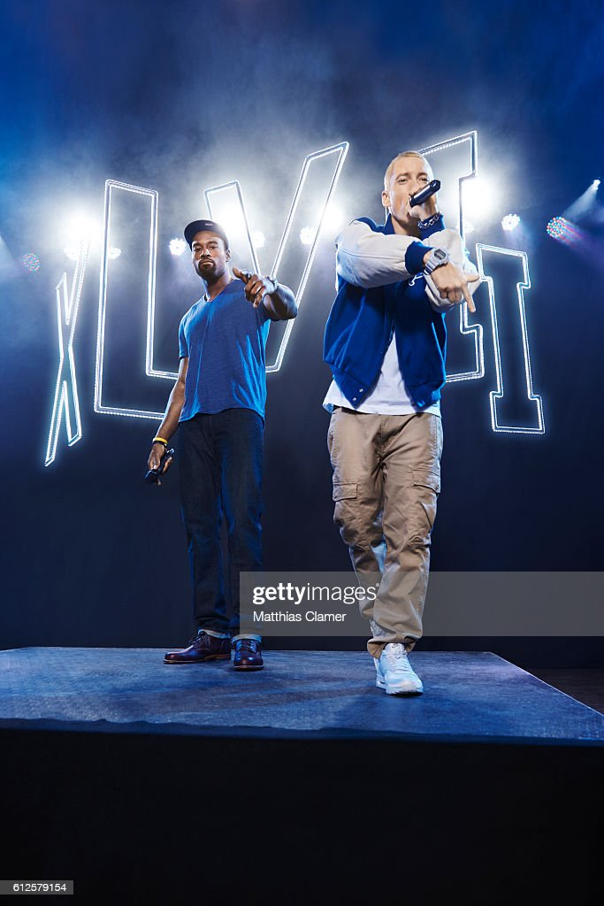 Rapper Eminem and football player Calvin Johnson are photographed for ESPN Magazine, The Music Issue on December 17, 2013 at St Andrews Theater in Detroit, Michigan.