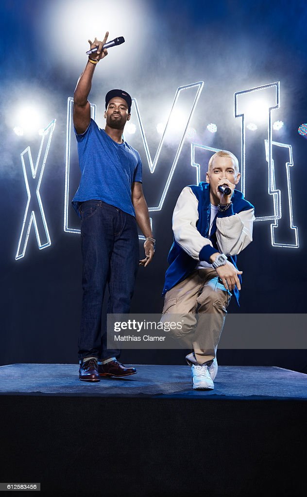 Rapper Eminem and football player Calvin Johnson are photographed for ESPN Magazine, The Music Issue on December 17, 2013 at St Andrews Theater in Detroit, Michigan. PUBLISHED