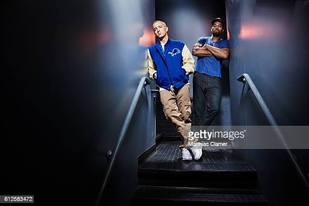 Rapper Eminem and football player Calvin Johnson are photographed for ESPN Magazine The Music Issue on December 17 2013 at St Andrews Theater in...