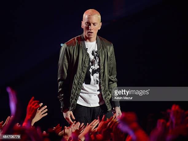 Rapper Eminem performs onstage at the 2014 MTV Movie Awards at Nokia Theatre LA Live on April 13 2014 in Los Angeles California