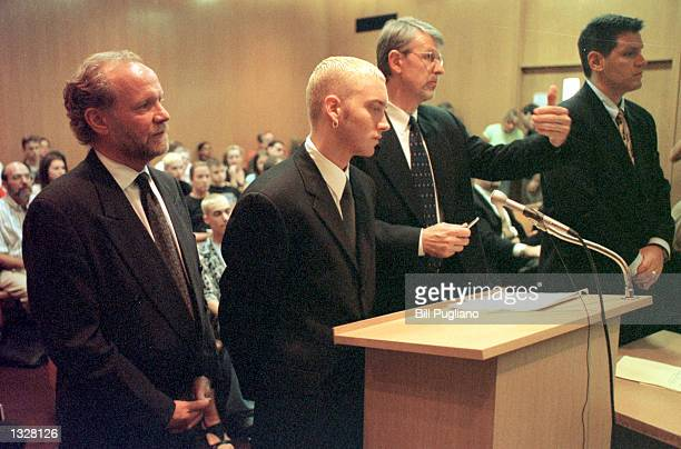 Rapper Eminem second left stands with his attorneys during his sentencing hearing on weapons charges June 28 2001 at Oakland County Circuit Court in...