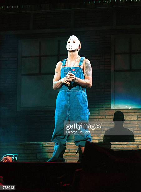Rapper Eminem stands onstage with a hockey mask at his performance in New Jersey Meadowlands Arena October 19 2000 in Secaucas NJ