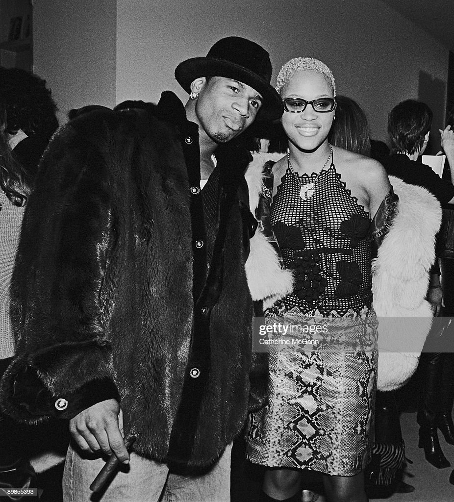 Rapper Eve (aka Eve Jihan Jeffers) (R) poses for a photo with an unidentified friend at a party for Harpers Bazaar magazine in 2000 in New York City, New York