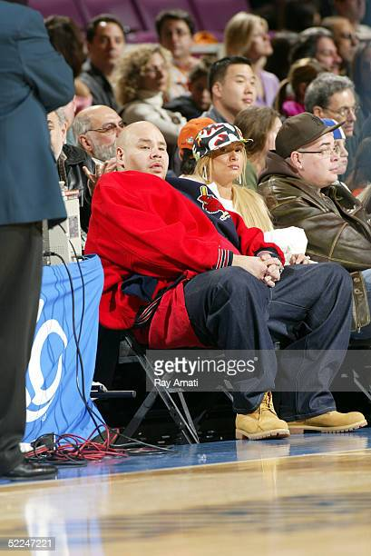 Rapper Fat Joe and his wife Lorena Cartegena watch the New York Knicks game against the Indiana Pacers on February 26 2005 at Madison Square Garden...