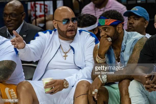 Rapper Fat Joe talks with rapper Jim Jones during the first half of the BIG3 basketball game between Killer 3s and Trilogy on July 14 2019 at...