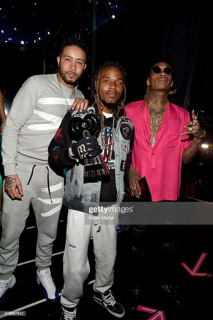 Rapper Fetty Wap (C) winner of Best New Artist and Wiz Khalifa backstage at the iHeartRadio Music Awards which broadcasted live on TBS, TNT, AND TRUTV from The Forum on April 3, 2016 in Inglewood, California.