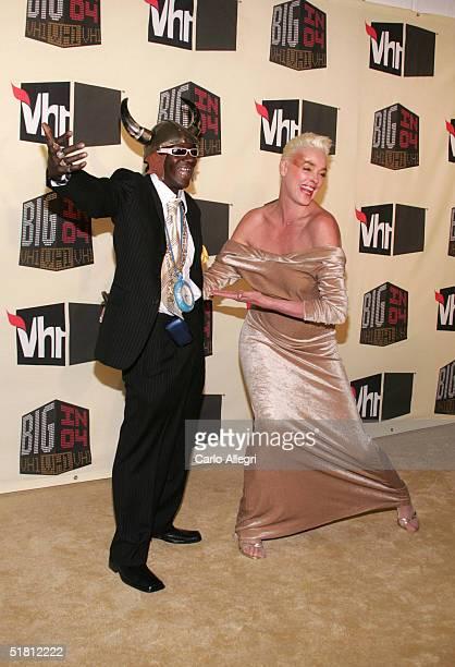 Rapper Flavor Flav and model Brigitte Nielsen attend the VH1 Big in '04 at the Shrine Auditorium December 1 2004 in Los Angeles California