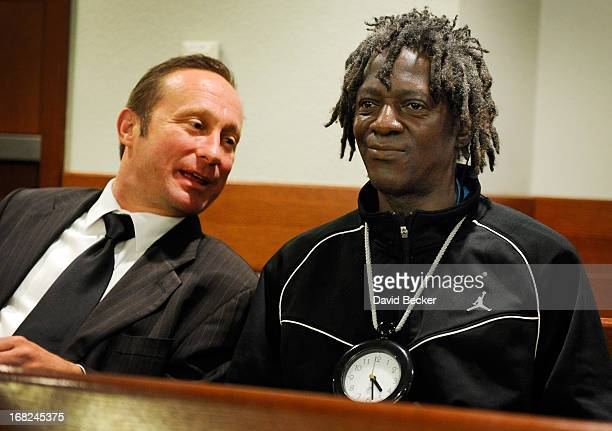 Rapper Flavor Flav confers with his attorney Tony Abbatangelo before making an appearance at the Clark County Regional Justice Center during his...