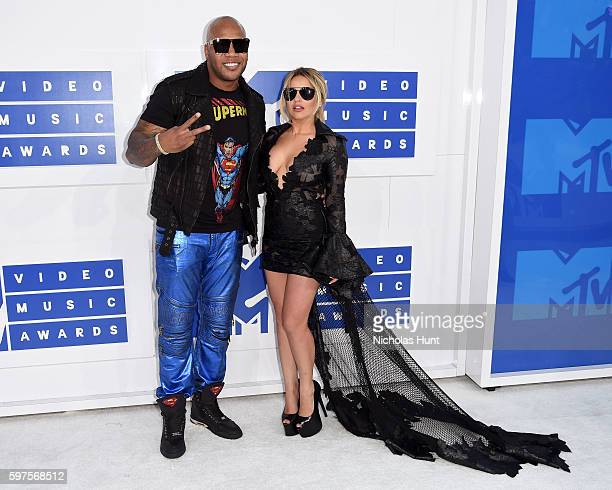 Rapper Flo Rida and guest attend the 2016 MTV Video Music Awards at Madison Square Garden on August 28 2016 in New York City