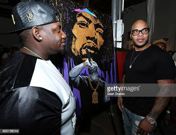 Rapper Flo Rida poses with artist Nicholas 'NB' Bailey after unveiling his painting titled 'Flo Hendrix' at Simply Gallery during Art Basel Miami...