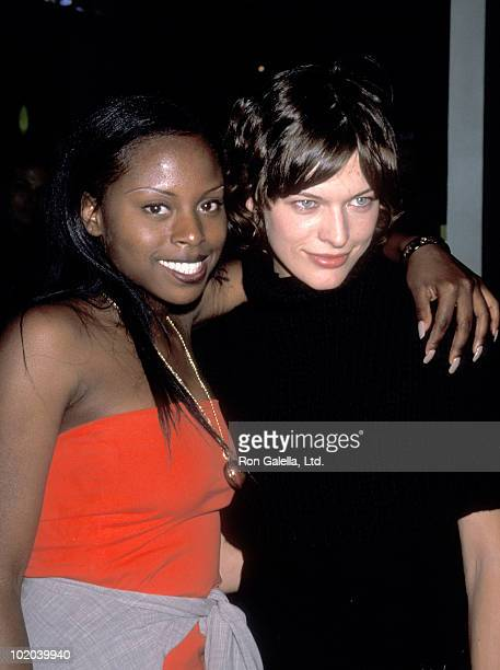 Rapper Foxy Brown and Model/Actress Milla Jovovich attend the 'Donna Karan Fashion Show' on September 18 1999 at Madison Avenue Outside the Plaza...