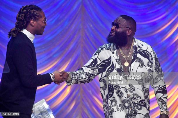 Rapper Future and Rapper Rick Ross greet each other at the 2017 BMI RB/HipHop Awards at Woodruff Arts Center on August 31 2017 in Atlanta Georgia