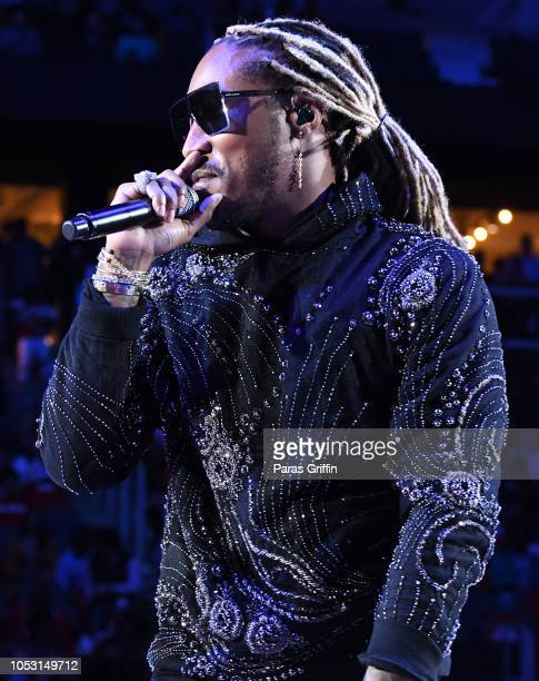 Rapper Future performs during halftime of the game between the Dallas Mavericks and the Atlanta Hawks on October 24 2018 at State Farm Arena in...