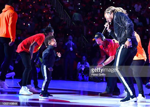 Rapper Future performs in concert with his son Future Zahir Wilburn during halftime of the game between the Dallas Mavericks and the Atlanta Hawks on...