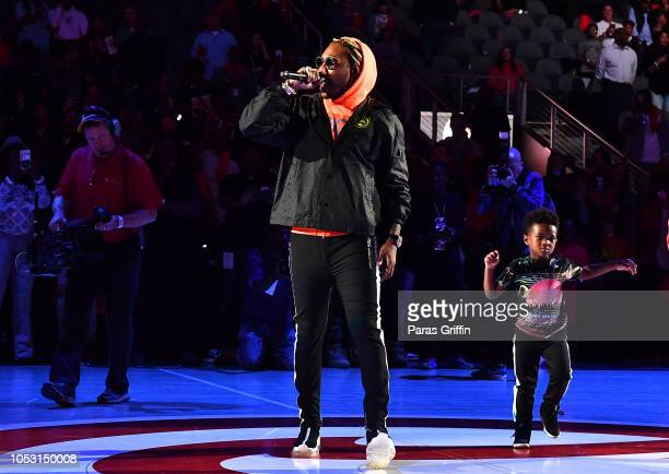 Rapper Future performs in concert with his son Future Zahir Wilburn after the game between the Dallas Mavericks and the Atlanta Hawks on October 24...