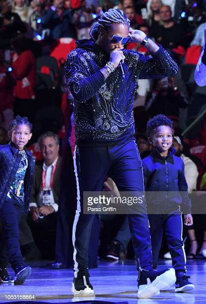 Rapper Future performs in concert with his sons during halftime of the game between the Dallas Mavericks and the Atlanta Hawks on October 24 2018 at...