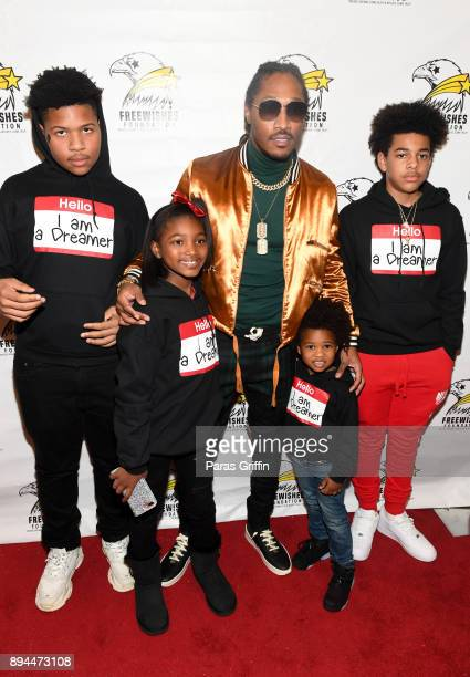 Rapper Future pose with his children at 5th Annual FreeWishes Foundation A Winter Wishland at Bessie Branham Park on December 17, 2017 in Atlanta,...
