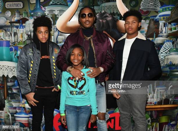 Rapper Future pose with his children at Ferdinand special screening hosted by Future FreeWishes Foundation at Regal Atlantic Station on December 9...