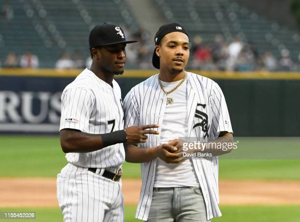 Rapper G Herbo with Tim Anderson of the Chicago White Sox after throwing out a ceremonial first pitch before the game between the Chicago White Sox...