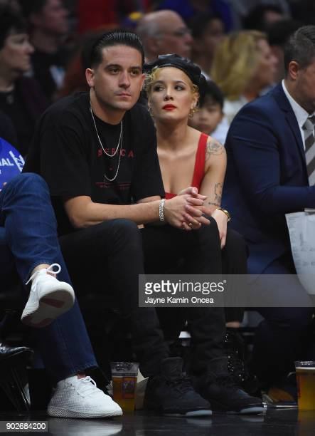 Rapper GEasy and Halsey attend the game between the Los Angeles Clippers and the Golden State Warriors on January 6 2018 in Los Angeles California...
