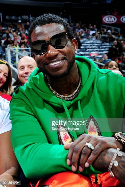 Rapper Gucci Mane enjoys the game between the Atlanta Hawks and Brooklyn Nets on January 12 2018 at Philips Arena in Atlanta Georgia NOTE TO USER...