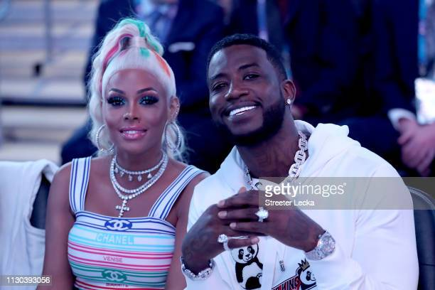 Rapper Gucci Mane sits with his wife Keyshia Ka'Oir before Team LeBron takes on Team Giannis during the NBA AllStar game as part of the 2019 NBA...