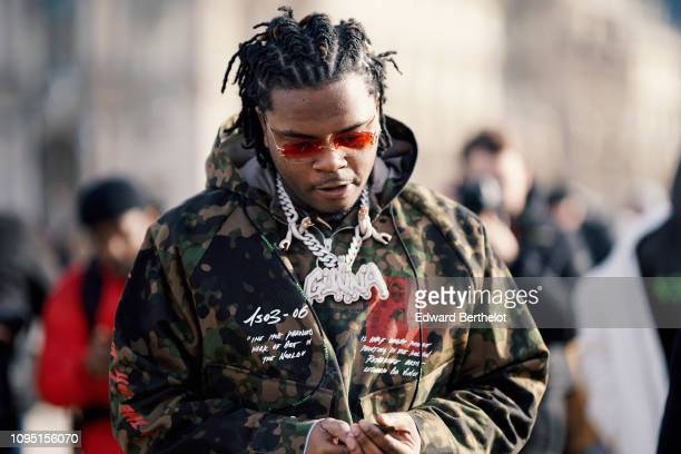 Rapper Gunna wears a military camouflage print jacket outside OffWhite during Paris Fashion Week Menswear F/W 20192020 on January 16 2019 in Paris...