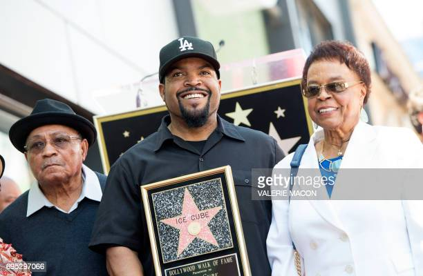 Rapper Ice Cube and his parents attend Ice Cube's star unveiling ceremony on the Hollywood Walk of Fame, on June 12 in Hollywood, California. / AFP...