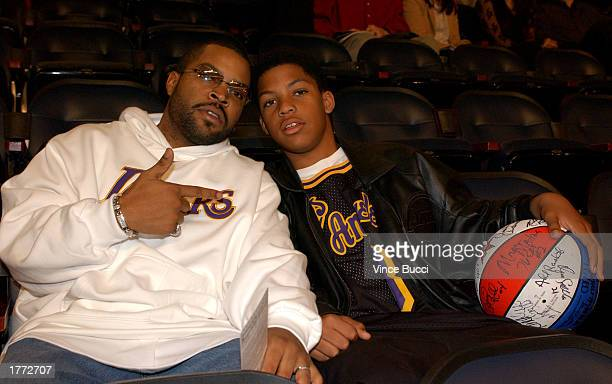 Rapper Ice Cube and his son Oshay wait for the action to start at the 2003 NBA AllStar game at the Phillips Arena February 9 2003 in Atlanta Georgia
