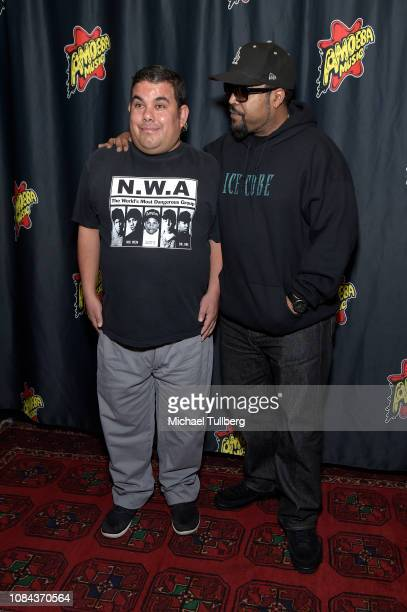 Rapper Ice Cube poses with a fan at a meet-and-greet in promotion of his new CD ``Everythangs Corrupt' at Amoeba Music on December 18, 2018 in...