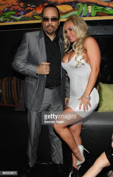 Rapper IceT and model Coco pose at Coco's birthday party at the Imperial Club on March 21 2009 in New York City