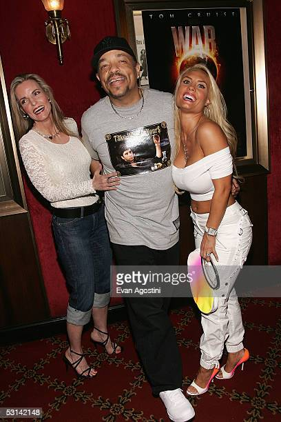 Rapper IceT his wife Coco and her mother attend the premiere of War Of The Worlds at the Ziegfeld Theatre on June 23 2005 in New York City