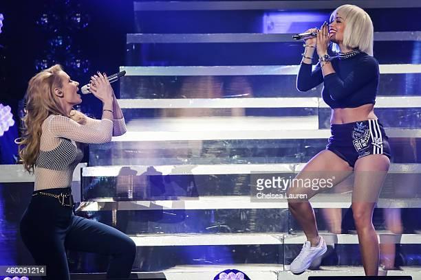 Rapper Iggy Azalea and singer Rita Ora perform at KIIS FM's Jingle Ball at Staples Center on December 5 2014 in Los Angeles California