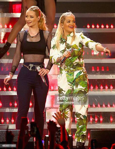 Rapper Iggy Azalea and singer Rita Ora perform onstage during 1035 KISS FM's Jingle Ball 2014 at Allstate Arena on December 18 2014 in Chicago...