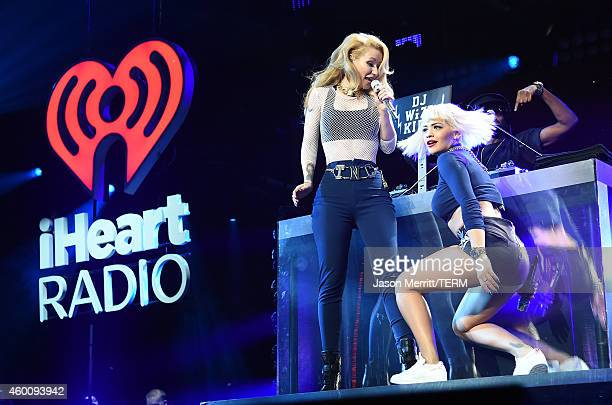 Rapper Iggy Azalea and singer Rita Ora perform onstage during KIIS FM's Jingle Ball 2014 powered by LINE at Staples Center on December 5 2014 in Los...