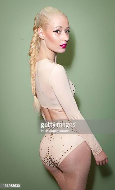 Rapper Iggy Azalea poses backstage at the 2012 Closer To My Dreams Tour at Club Nokia on September 4 2012 in Los Angeles California