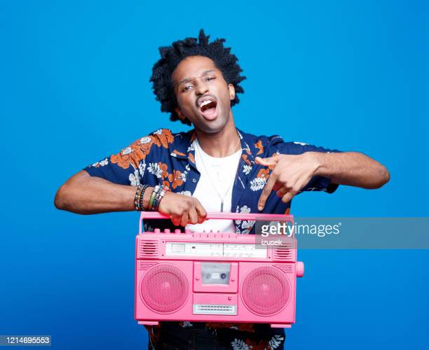 rapper in hawaiian shirt holding pink boom box - rapper stock pictures, royalty-free photos & images