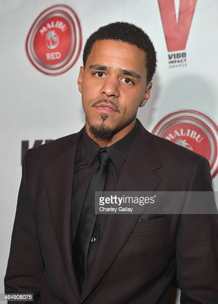 Rapper J Cole attends the VIBE Impact Awards presented in partnership with Malibu Red at the Carondelet House on January 24 2014 in Los Angeles...