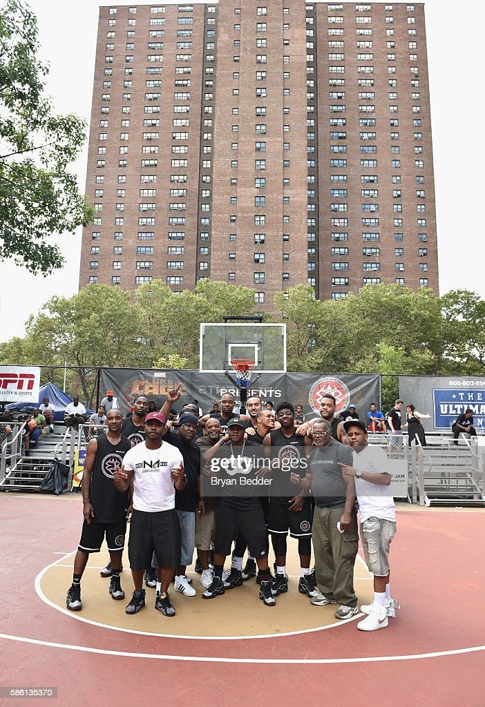 Rapper Jadakiss (C) poses with his team during the Launch of the new Reebok Question Mid EBC & A5 with Cam'ron and Jadakiss at Rucker Park on August 4, 2016 in New York City.