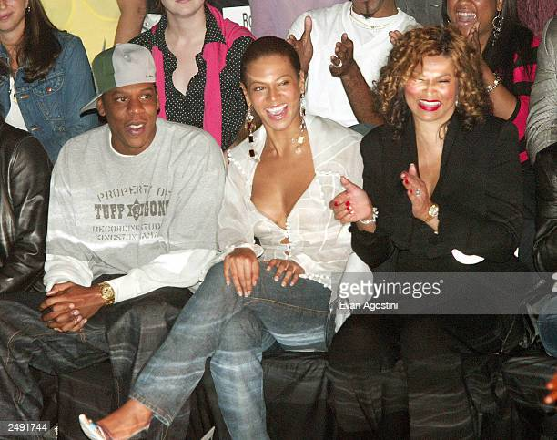 Rapper Jay Z and singer Beyonce Knowles with her mother Tina are seen at the Rosa Cha by Amir Slama Spring/Summer 2004 Collection at Bryant Park...